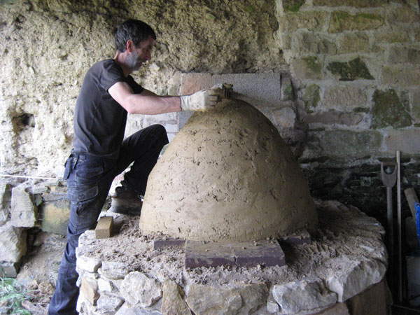 Andrew Hubbard making a wood fired cob oven on a smallholder training course